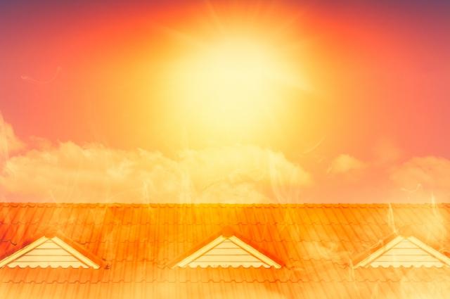 Orange sun over rooftop