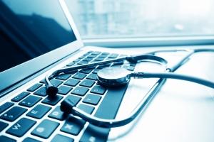 Stethoscope sitting on laptop keyboard