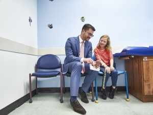 Doctor talking with child
