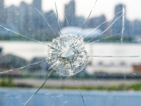 Pane of glass with bullet hole in it